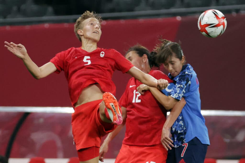Footballer Quinn makes history as first out trans Olympian to compete in Tokyo: 'I feel proud'